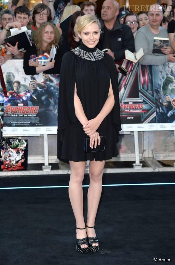 """En avril dernier, Elizabeth Olsen opte pour le total look noir à la première londonienne de """"Avengers : L'ère d'Ultron"""", dans une robe signée Saint Laurent."""