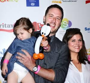 Tiffani-Amber Thiessen, son mari Brady et leur petite Harper.