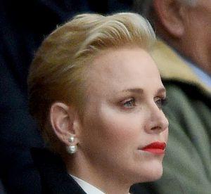 Charlene de Monaco : mine austère au stade... en compagnie du prince Harry !