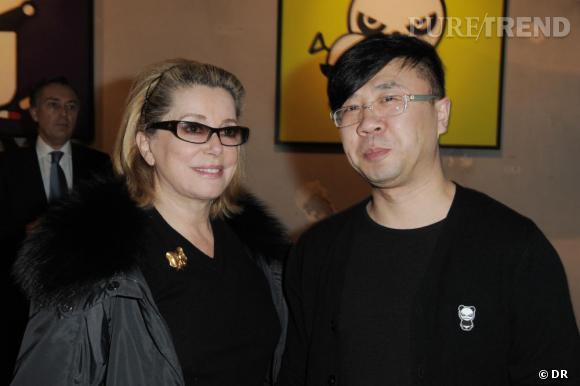 L'actrice française Catherine Deneuve avec l'artite chinois Ji-Ji
