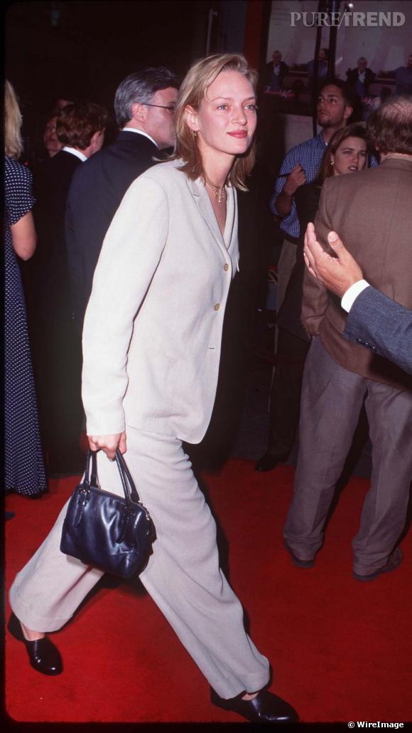 En 1995, Uma tente le masculin-féminin, un look mal maîtrisé.