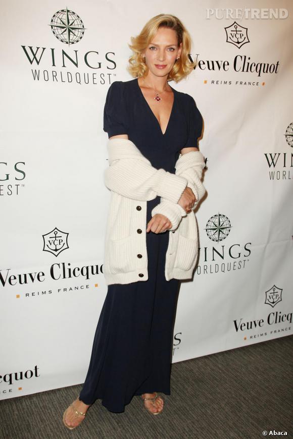 2010, c'est le retour du pull en laine ! Pourtant Uma était resplendissante dans cette robe bleue toute simple ! Dommage.