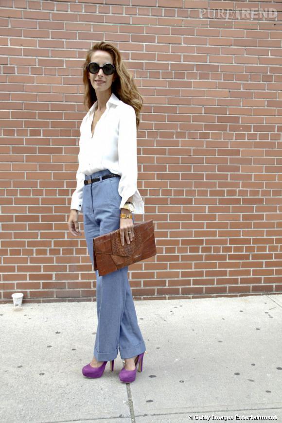 C'est qui ?    Parisa Afshari Rad, créatrice de mode.       Son look ?    Une chemise et un pantalon de sa propre griffe, une pochette en croco vintage et des lunettes Chanel.