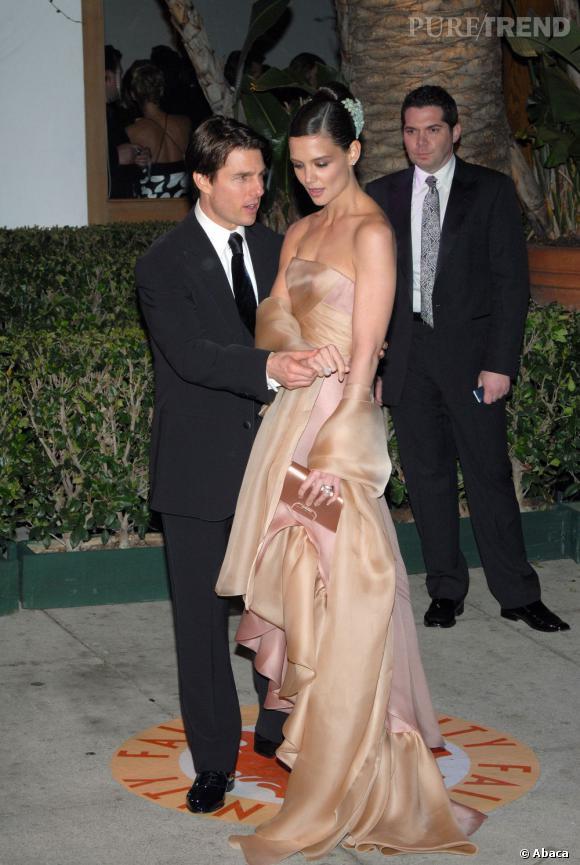 En couple sur tapis rouge  : pour son troisième mariage, Tom Cruise sort le grand jeu. Katie Holmes sait ce que veut dire allure hollywoodienne et elle le montre. Katie remporte le point.