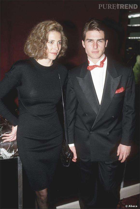 En couple sur tapis rouge  : avec son allure de petit garçon ayant piqué le costume de son père et Mimi Rogers avec son beauty look en berne, ils sont loin de faire sensation.