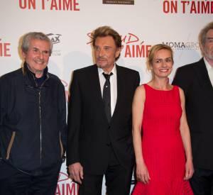 """Claude Lelouch, Johnny Hallyday, Sandrine Bonnaire et Eddy Mitchell à la première de """"Salaud, on t'aime"""" le 31 mars 2014 à Paris."""