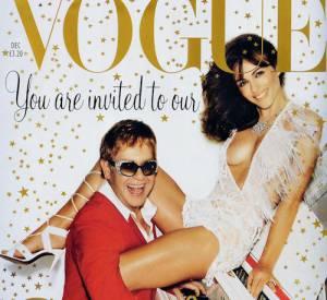 Elton John et Liz Hurley pour Vogue en 2002.