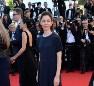 Sofia Coppola en robe Valentino et bijoux Chopard lors de la montée des marches pour la cérémonie de clôture du 67ème Festival de Cannes.