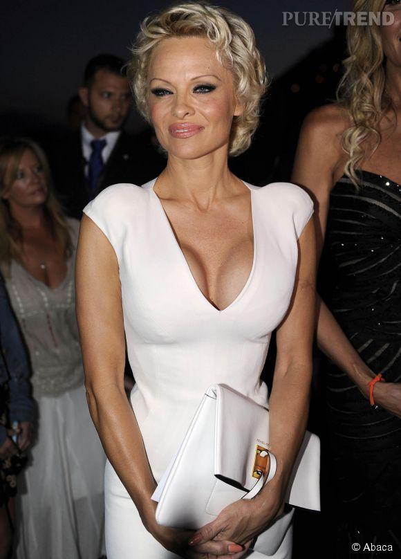 Pamela Anderson et son décolleté XXL, dimanche 15 juin 2014 au Festival du film de Taormine en Sicile.