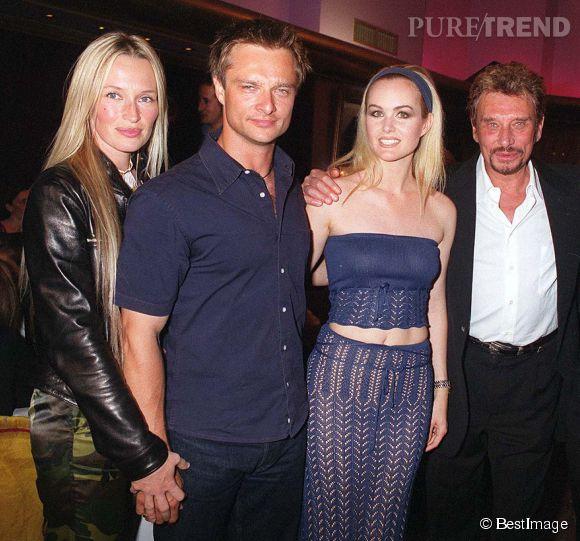 Estelle, à l'époque Hallyday, avec son mari David, son beau-père Johnny et sa belle-mère Laeticia pour les 56 ans de Johnny en 1999.