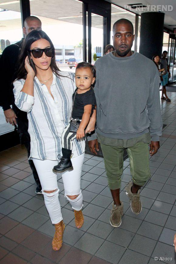 Le couple West et leur petite fille, North.