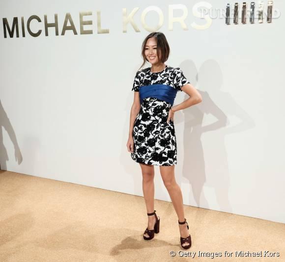Aimee Song porte une robe Michael Kors Collection lors de la soirée de lancement du nouveau parfum Gold de Michael Kors à New York le 13 septembre 2015.