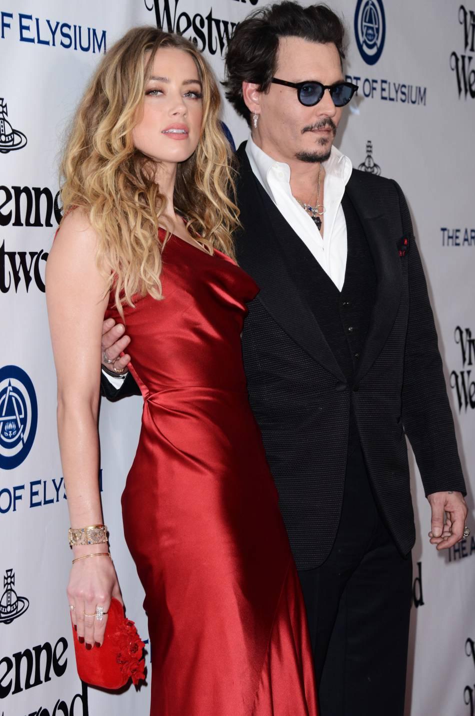 Amber Heard, plus sexy que jamais aux bras de son mari johnny Depp.