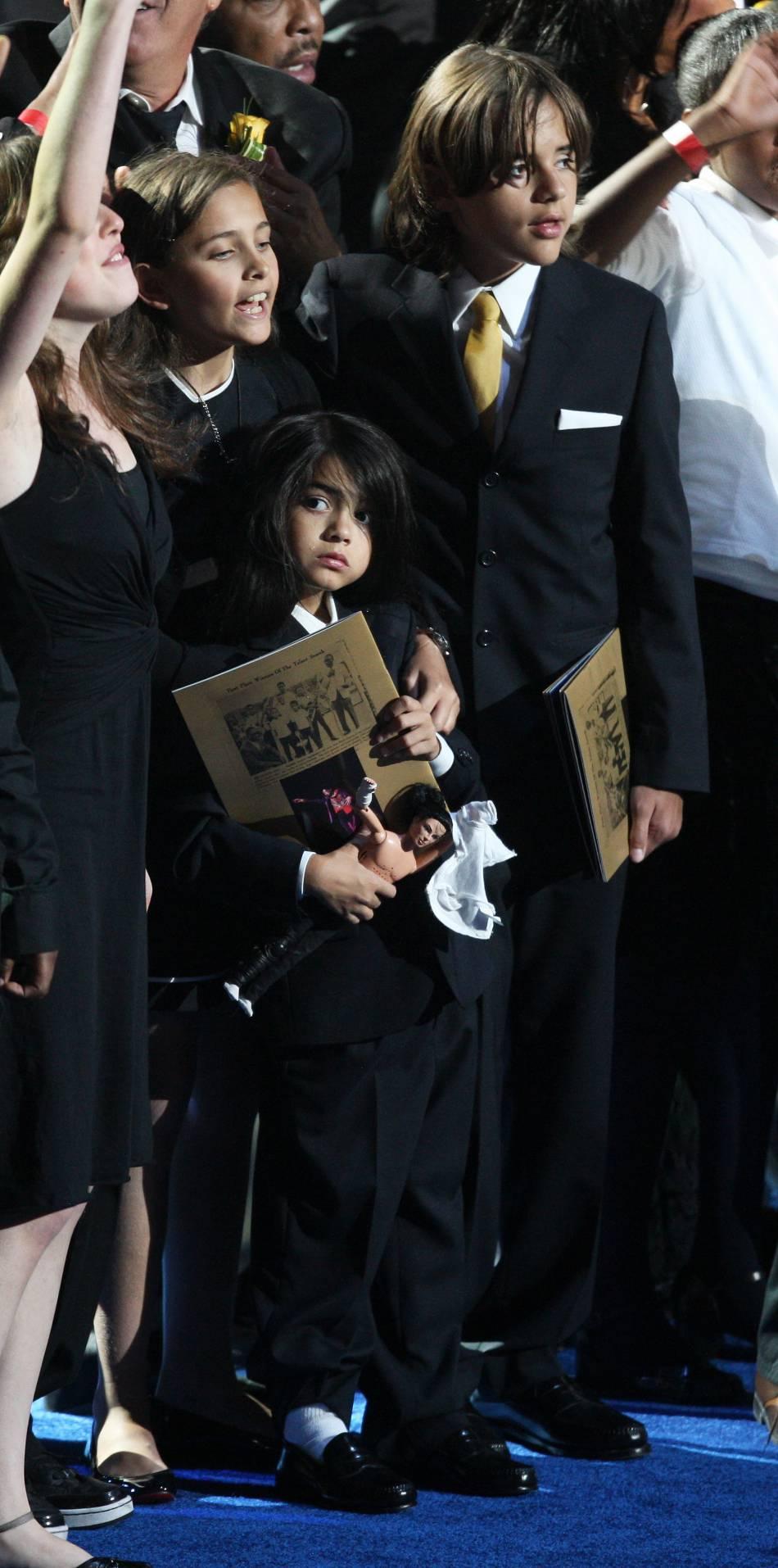 Paris, Prince et Blanket lors de l'enterrement de leur père en 2009.