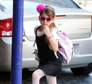 Suri Cruise a un certain talent pour l'accessoirisation, version rose girly.