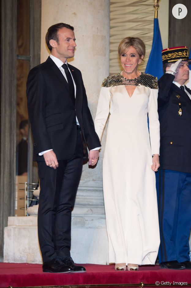 Brigitte Macron en robe longue Louis Vuitton lors d'une soirée à l'Elysées.