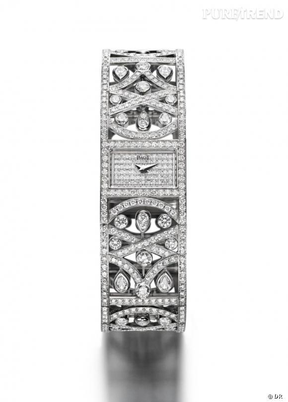 Piaget       Montre en or blanc 18 carats. Boîte et cadran sertis de 154 diamants taille brillant (env. 0.9 ct). Bracelet or blanc 18 carats serti de 604 diamants taille brillant (env. 11.4 cts) et 8 diamants taille poire (env. 0.9 ct). Mouvement quartz Piaget 56P