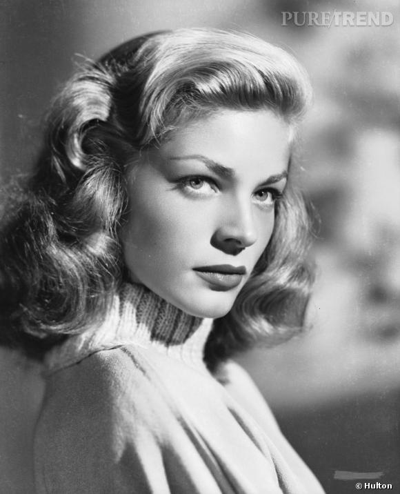 Blondes Vs Brunes       Lauren Bacall arbore la coupe emblématique de l'icône hollywoodienne. La crinière dorée se dompte avec sophistication en crans et boucles.