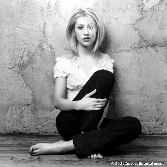 Christina Aguilera en 1999 : coupe au carré, air de petite fille sage... On est loin de la perfection mais la chanteuse reste naturelle.