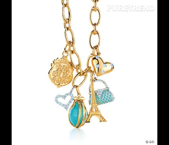 "Charms Tiffany & Co   Chaîne en or jaune, charms ""Olympian"" en or jaune, ""Mini diamond heart"" en diamants et platine, oeuf en turquoise et or jaune Jean Schlumberger, ""Tour Eiffel"" en or jaune, ""Purse"" en plarine, émail et diamants, ""Etoile heart"" en platine, or jaune et diamants.   Prix sur demande. www.tiffany.fr"
