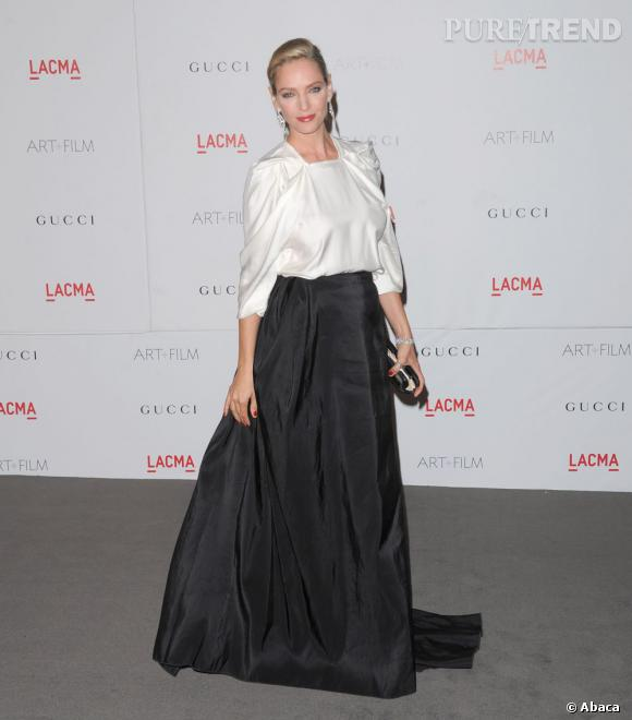 L'actrice, glamour et chic dans une tenue tout en drapé signée Lanvin.