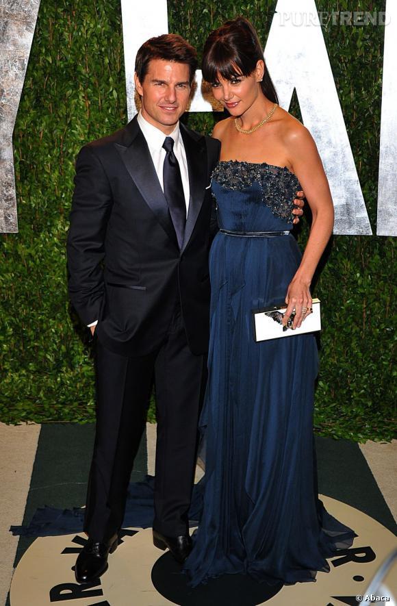 Katie Holmes en robe Elie Saab Haute Couture Automne-Hiver 2011/2012 au côté de son mari Tom Cruise.