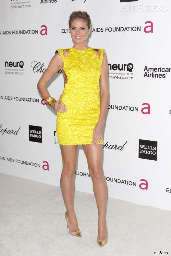 Heidi Klum était l'une des rares stars à opter pour une mini robe. Invitée à l'after party Elton John, le top a fait sensation en robe Haute Couture de chez Versace.