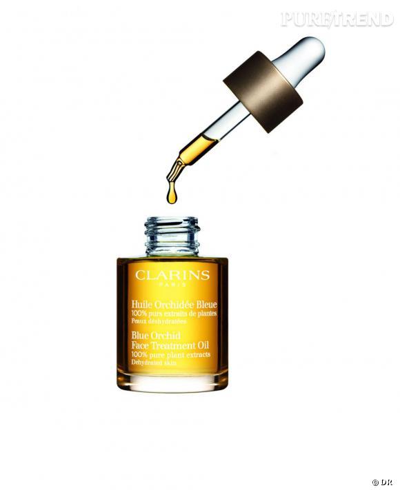 Notre shopping spécial huiles essentielles     Ce soin anti-âge revitalise votre peau et lui donne un nouvel éclat grâce à l'action combinée de l'huile essentielle d'orchidée, de bois de rose et de patchouli.   Huile Orchidée Bleue, Clarins, 36,40 euros (30 ml)