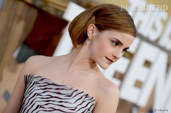 """Emma Watson à la première de """"This is the end"""" à Los Angeles: l'actrice plaque ses cheveux en arrière et poudre son teint vamp."""