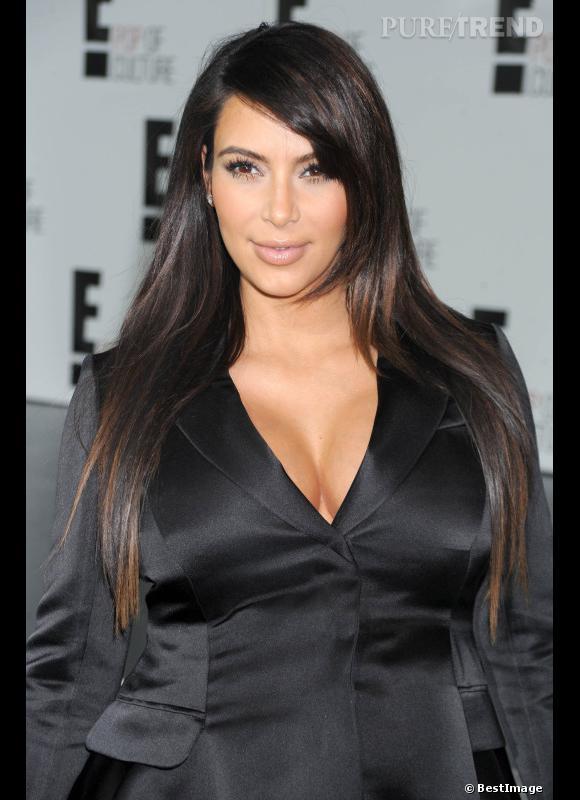 2012, Kim est enceinte, son visage s'arrondit légèrement, en même temps que son ventre.