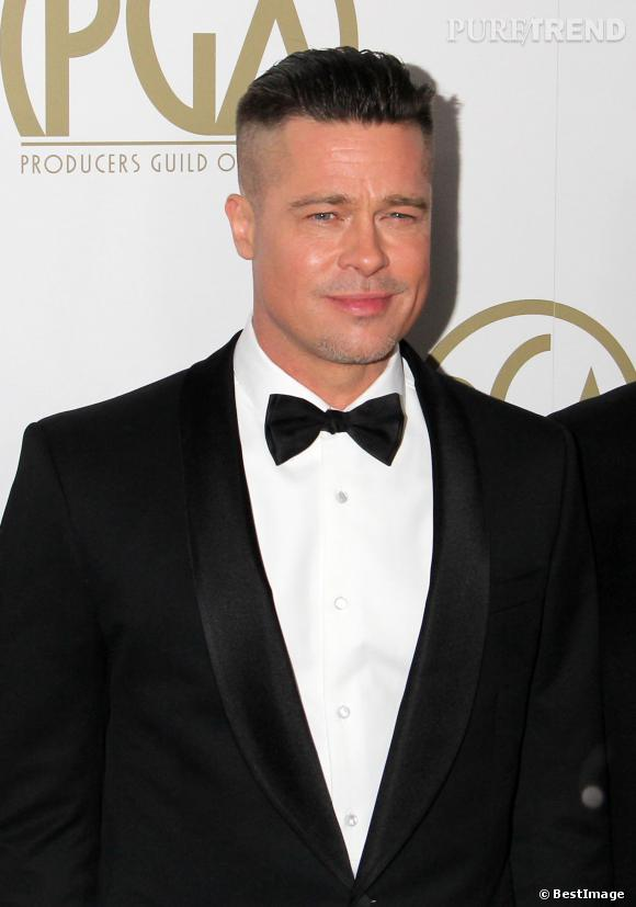 Brad Pitt a une nouvelle coupe de cheveux qu'il affiche sur le tapis rouge des Producers Guild Awards le 19 janvier 2014.