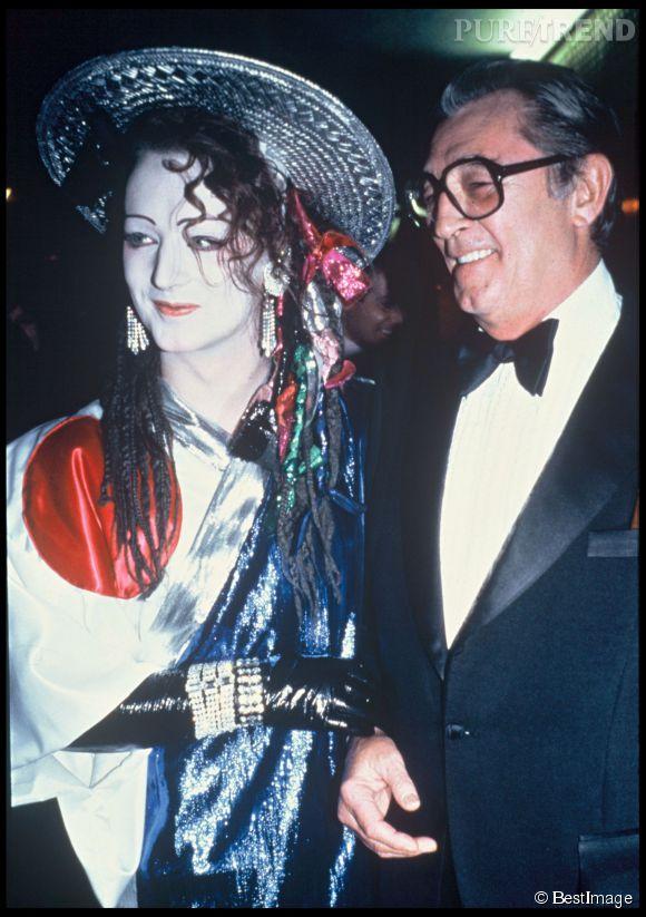 Boy George façon Geisha de l'espace avec Robert Mitchum en 1984.