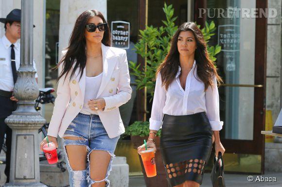 Kim Kardashian et Kourtney Kardashian en avril 2014.