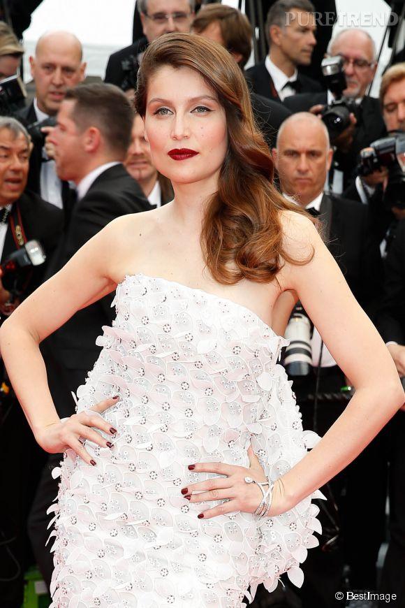 """Laeitia Casta et sa cascade de cheveux lors de la montée des marches du film """"Grace de Monaco"""" pour l'ouverture du 67 ème Festival du film de Cannes, le 14 mai 2014."""