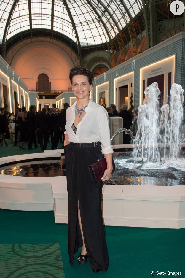 Juliette Binoche invitée d'honneur de la maison Bulgari à l'occasion du gala d'inauguration de la 27ème Biennale des Antiquaires à Paris le 9 septembre 2014.