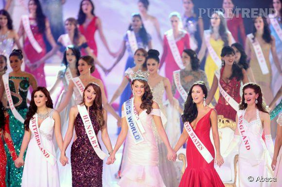 Au centre, Miss Monde 2014 avec ses deux dauphines, Miss Hongrie à gauche et Miss États-Unis à droite.