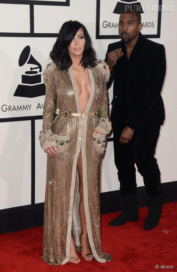 Kim en Jean Paul Gaultier Couture et Kanye en Balmain : couple amoureux et stylé pour les Grammy Awards, le 8 février 2015.