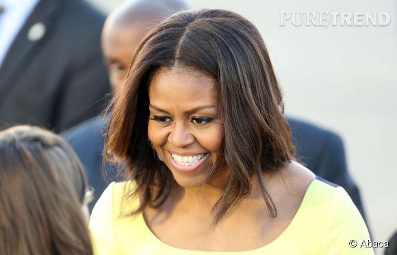 Michelle Obama montre l'exemple à ses filles à Londres.