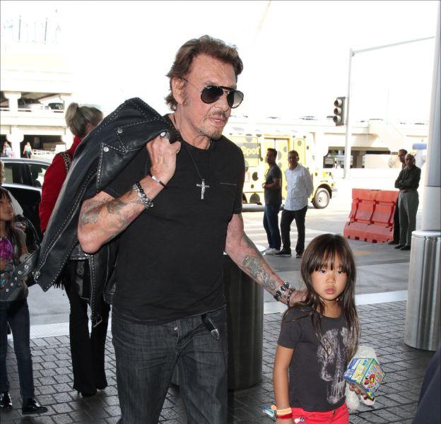 Johnny Hallyday et sa cadette, Joy, photographiés en octobre 2014.