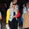 En couv de  People , elle pose aux côtés de Rob Kardashian.