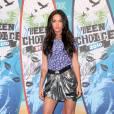 Megan Fox sublime sa silhouette avec des Lady Peep mauves semelles plateformes et peep-toe.