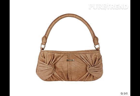 """Sac Burberry       Pourquoi on aime le """"sling bag"""" de Burberry ? Parce qu'il reprend le drapé du sublime trench de la collection Printemps-Eté 2010 signée Christopher Bailey. Ici en venrsion beige rosé en aligator.      Prix sur demande"""