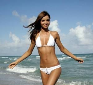 Miranda Kerr Vs Doutzen Kroes : qui porte le mieux le bikini blanc ?