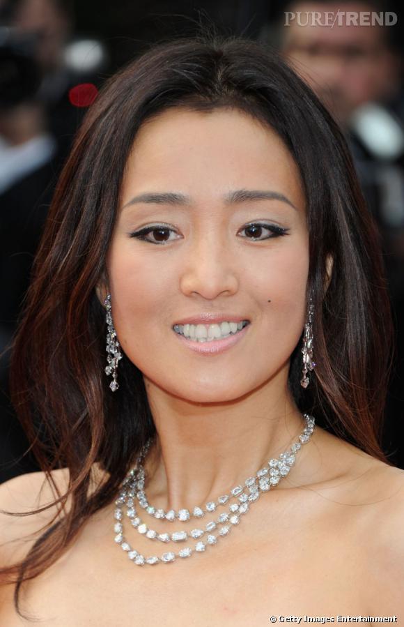Gong Li en Roberto Cavalli, avant sa montée des marches à Cannes.