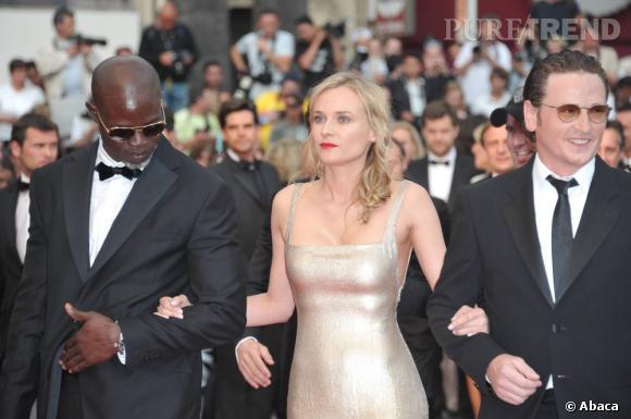 """Djimon Hounsou, Diane Kruger et Benoit Magimel sur le tapis rouge de """"Sleeping Beauty""""."""