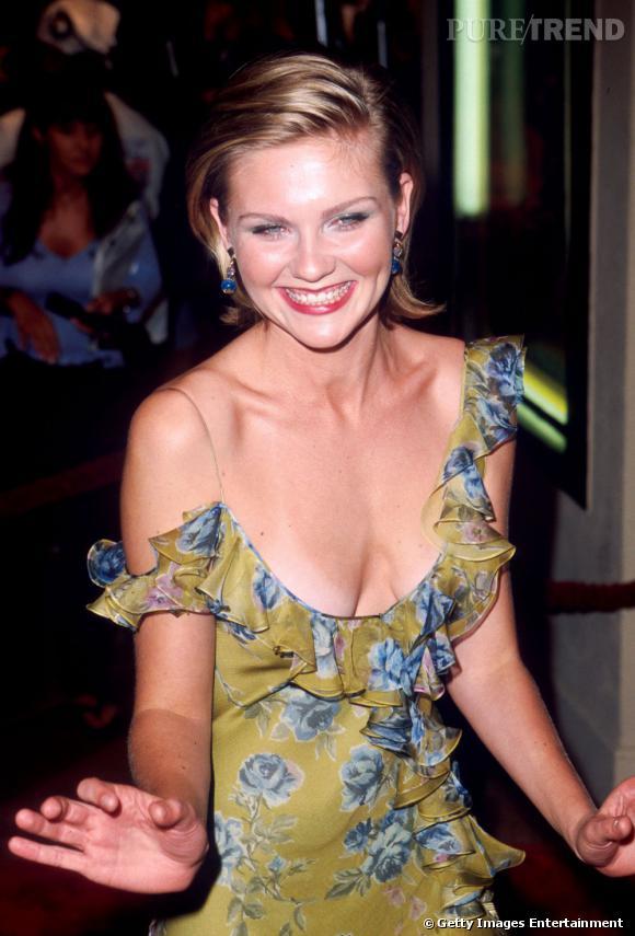 Une robe qui tombe et qui laisse entrevoir la marque de bronzage de l'été... Rien de moins glamour.