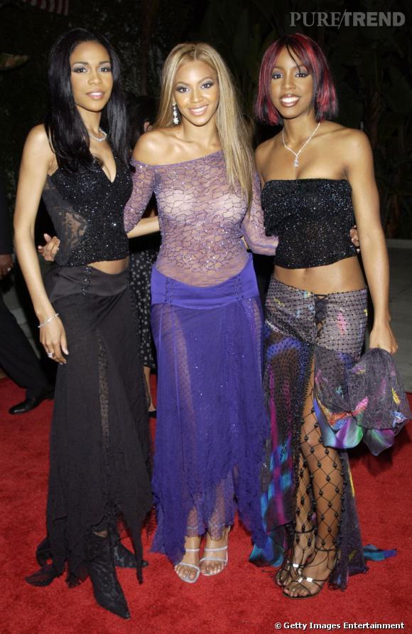 Les Destiny's Child en 2002 aux GRAMMY Awards. Fini les couleurs flashy mais le nombril est toujours bien dévoilé.