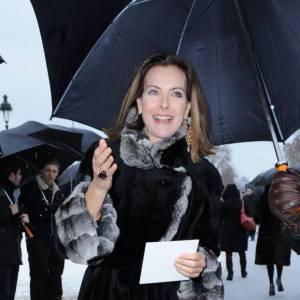Carole Bouquet en chemin pour le défilé Dior Haute Couture Printemps-Été 2013.