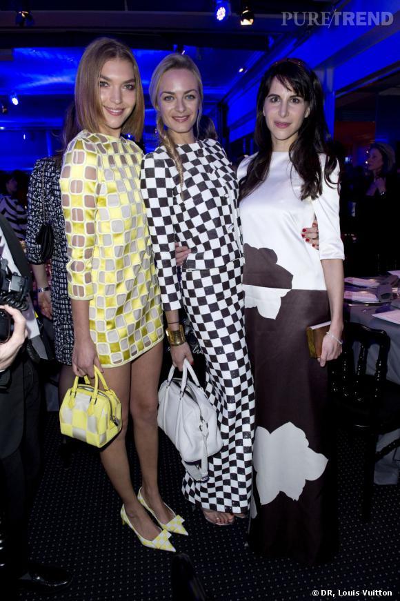 Arizona Muse, Virginie Courtin et Caroline Sieber toutes les trois en Louis Vuitton au dîner de la mode Sidaction à Paris.