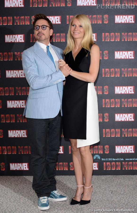 Gwyneth Paltrow et Robert Downey JR pose pour la photo.